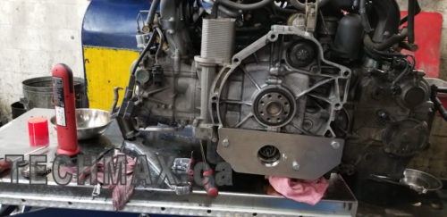 Porsche Carrera engine being repaired.