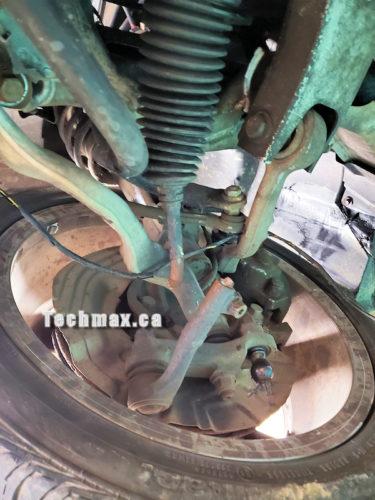 Broken Suspension Assembly